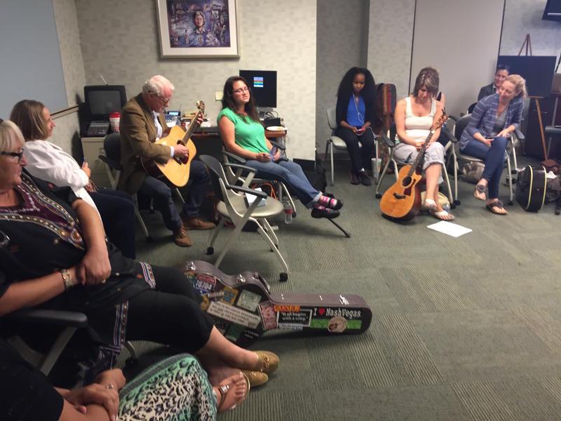 Sarah Kelley, in green, performs with songwriter Bob Regan at a Nashville VA clinic.