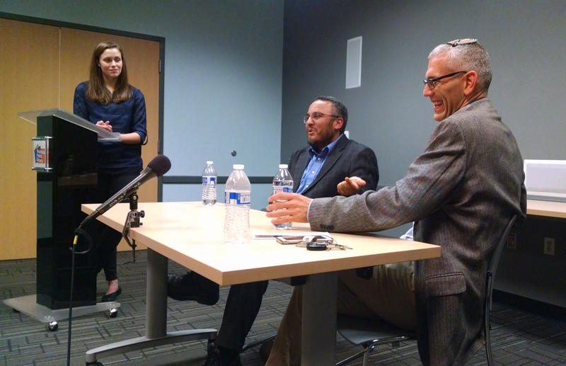 Ossama Bahloul and Phillip Ackerman-Lieberman share a laugh while answering questions Thursday night about the meaning of Shariah law.