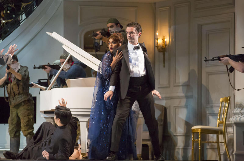 Soprano Danielle de Niese plays Roxane Cass, the opera singer who is held hostage, shown here with tenor John Irvin.