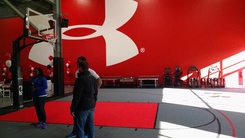 Under Armour's workout facilities include a basketball hoop and weight room.