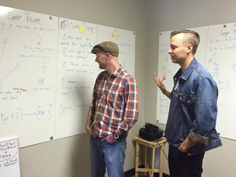 Founder Chris McMurtry, left, and chief operating officer Lee Kebler discuss the whiteboard flowchart that the next version of Dart's software might follow.