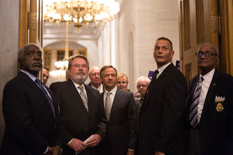 Gov. Bill Haslam (center) prepares to walk into the House chambers and give his annual state of the state address. Haslam says past cuts have put Tennessee in a position to spend more, especially on education.