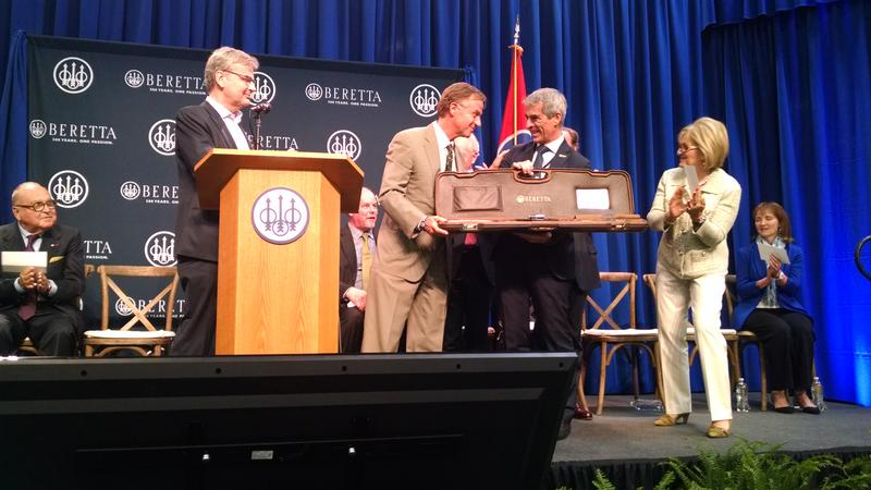 Beretta officials present Gov. Bill Haslam with the first shotgun made at the new Gallatin facility.