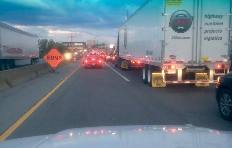 A behind-the-wheel photo texted from a driver to his wife, saying he will be late for dinner — again.