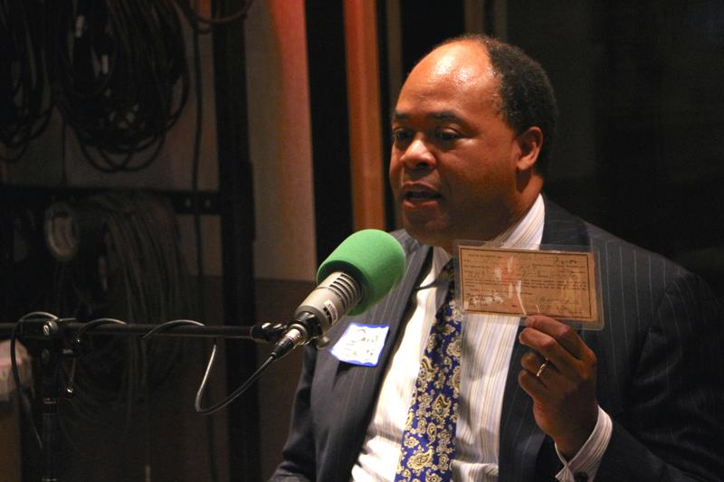 David Ewing holds up his great-great-grandmother's voter registration card.