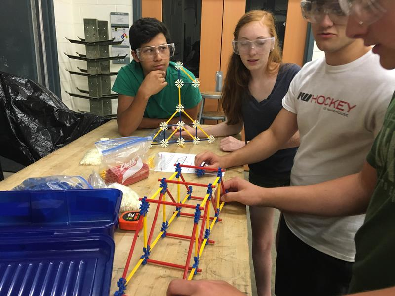 Students make plastic versions of trusses before cutting them out of wood.