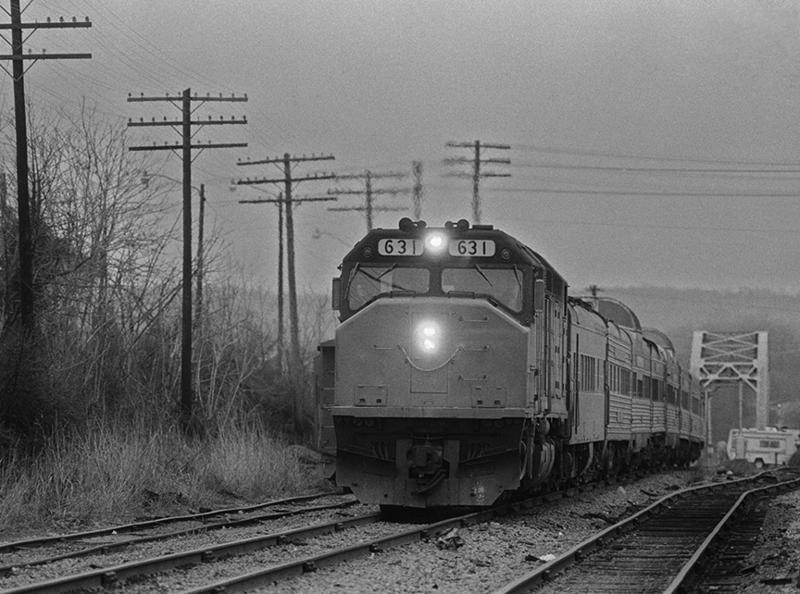 These black and white photos were taken in the final days of the Floridian. This photo shows the train arriving two hours behind schedule in Bowling Green, Kentucky, because of poor track conditions and waiting on freight traffic.