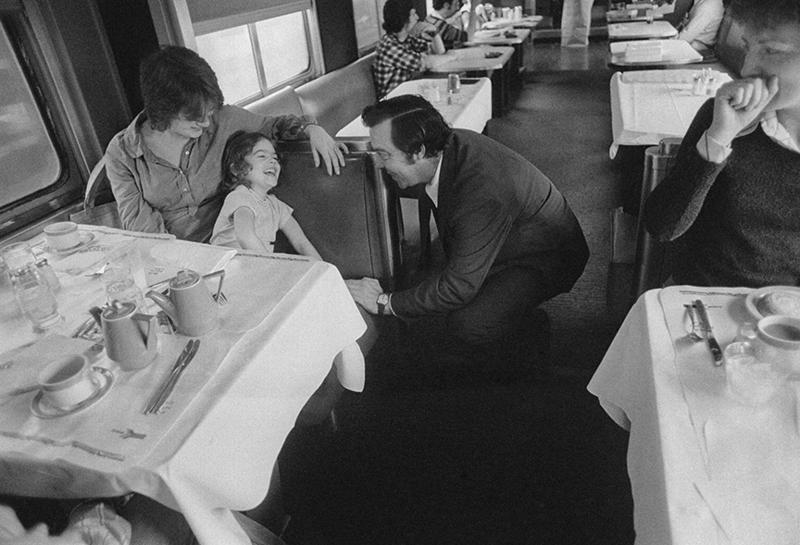 In the Floridian's dining car, Maitre d' Donald Mendez coaxes a laugh from 4-year-old Emily Stolt, sitting with her mother Margie.
