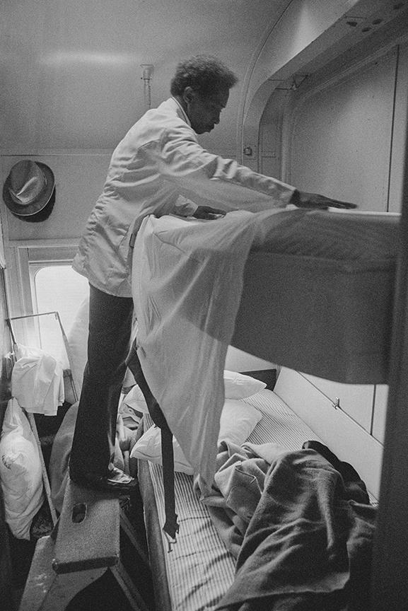Thomas Washington, a porter on the train, makes up a two-person sleeper as the train rolls through Georgia.