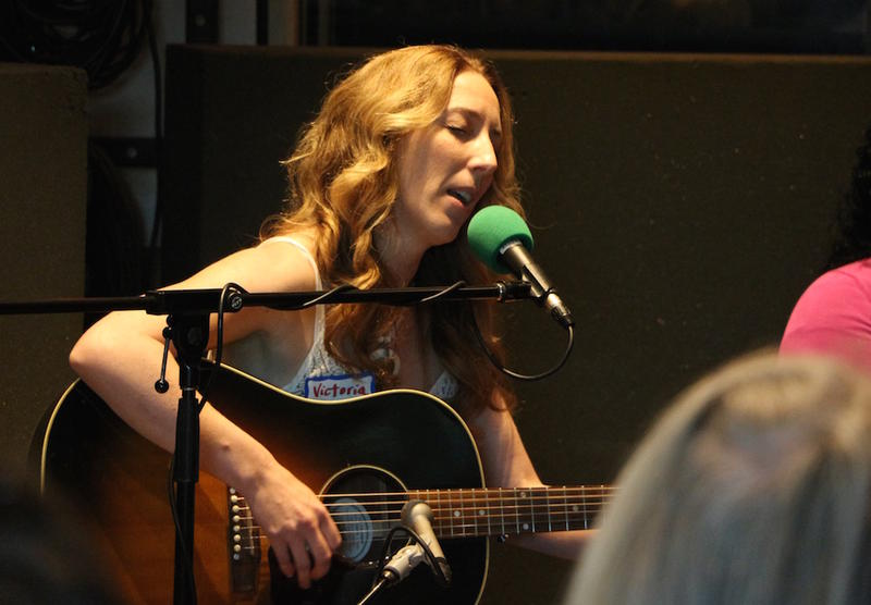Victoria Banks performs an original song at the live taping of Movers & Thinkers in June.