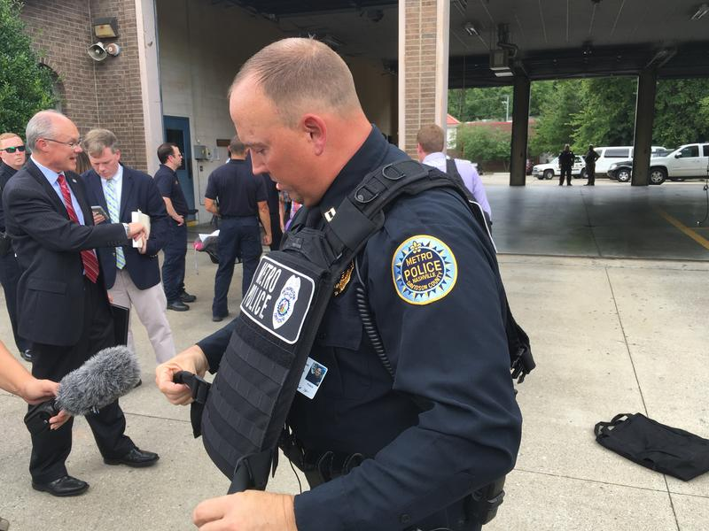 MNPD Capt. Keith Stephens shows off the new armored vest that the department wants officers to have in their squad cars along with a ballistic helmet.