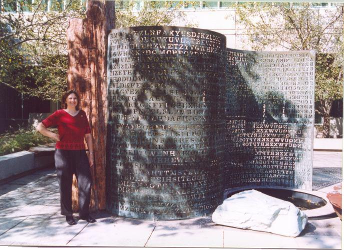 Elonka Dunin stands next to Kryptos in 2002, when she was allowed access to CIA's headquarters in Langley.