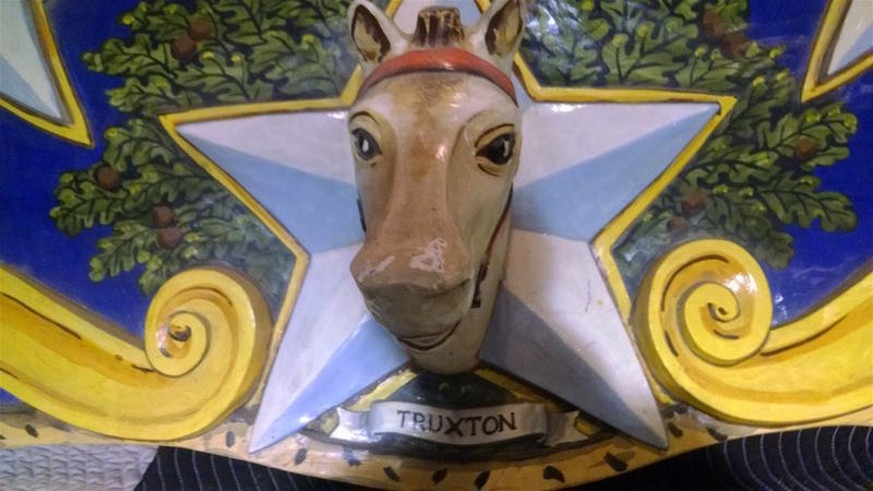 Truxton, a famed racehorse owned by President Andrew Jackson, appears on a shield.