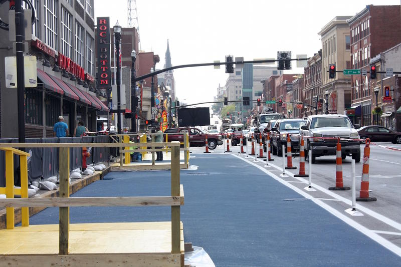 An experiment on Nashville's Lower Broadway adds pedestrian plazas in what used to be loading zones.