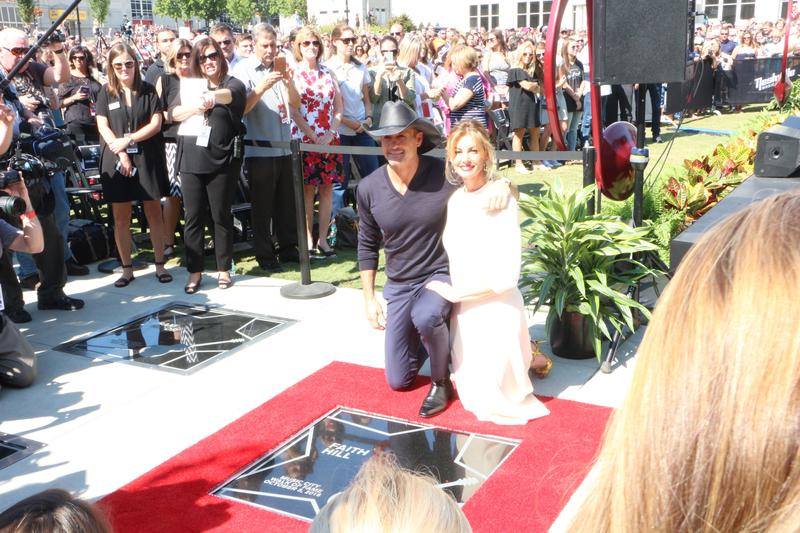 Country couple Faith Hill and Tim McGraw showcasing their stars on the Music City Walk of Fame.