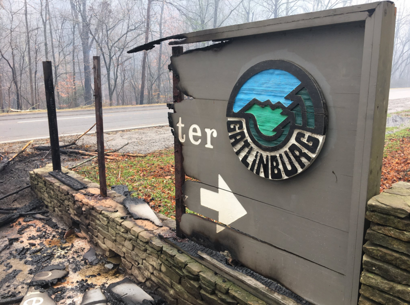 The welcome center sign wasn't spared as the Chimney Top Fire tore through Gatlinburg, burning at least 100 buildings.
