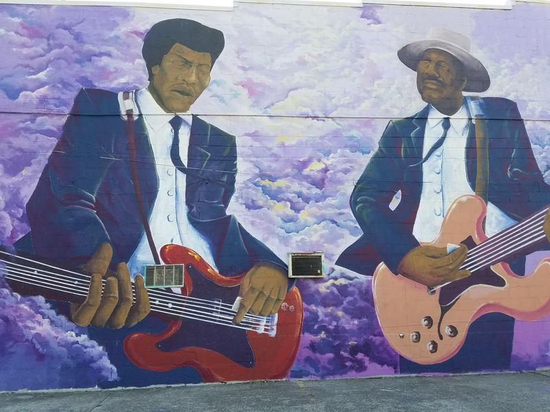 A new mural, one of several on Jefferson Street, shows Jimi Hendrix jamming with guitarist Johnny Jones. The mural is by  Woke3 and ArJae of Norf Art Collective.