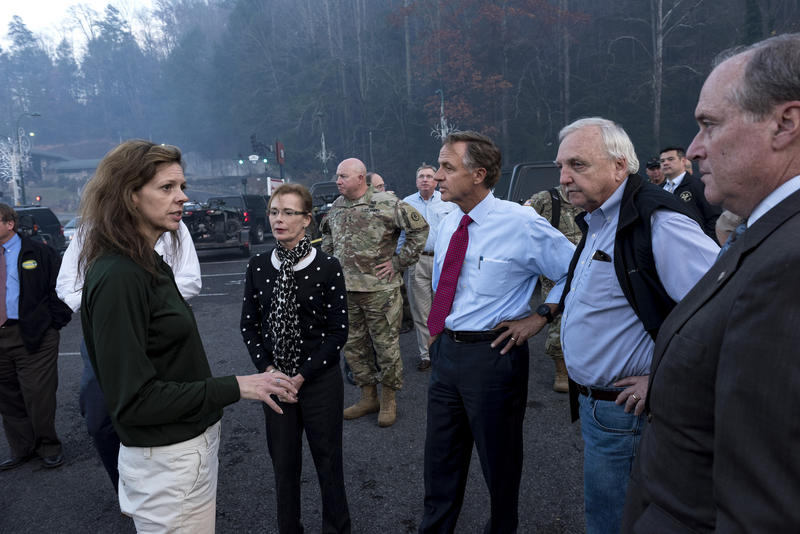 The morning after fire swept through Gatlinburg, state officials survey the damage. A physical communication breakdown is blamed for no evacuation order going to mobile devices.