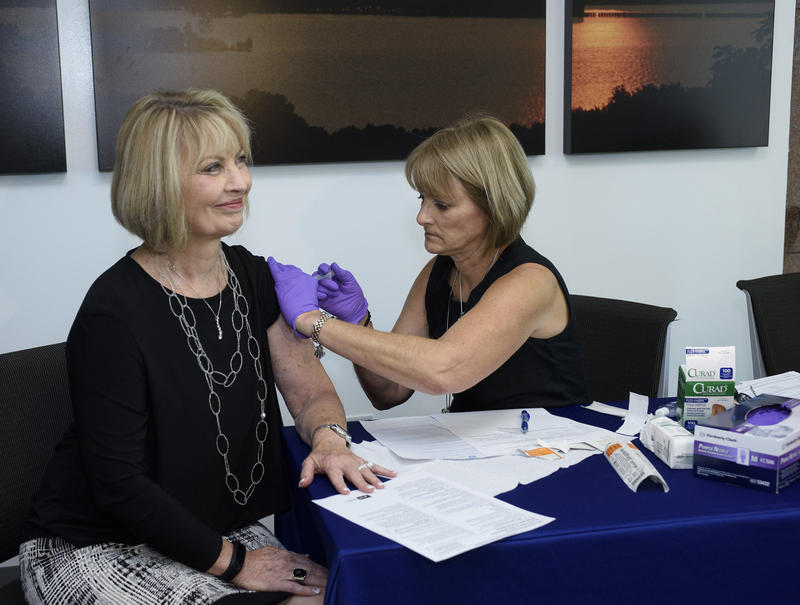 A Tennessee Department of Health official gives a flu vaccine shot in September. Infectious disease experts say there is still some benefit to getting the vaccine right now.