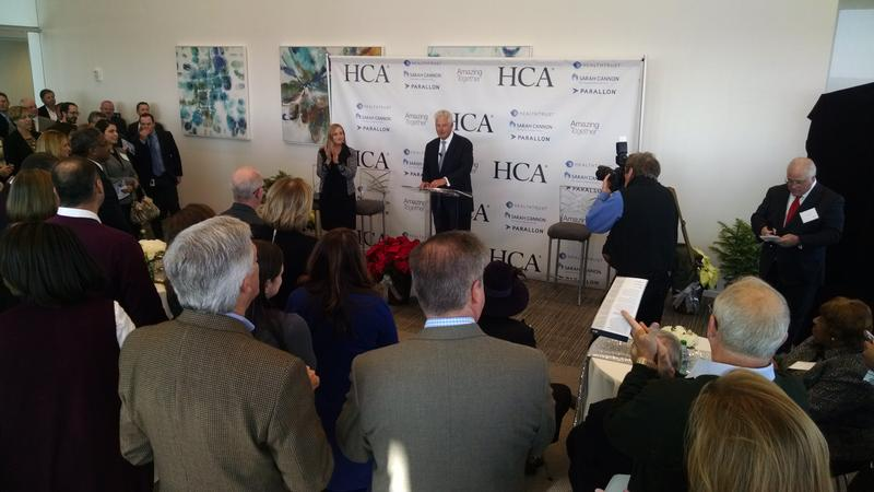 Milton Johnson, chairman and chief executive of HCA, announces the official opening of the company's new tower in the Gulch.