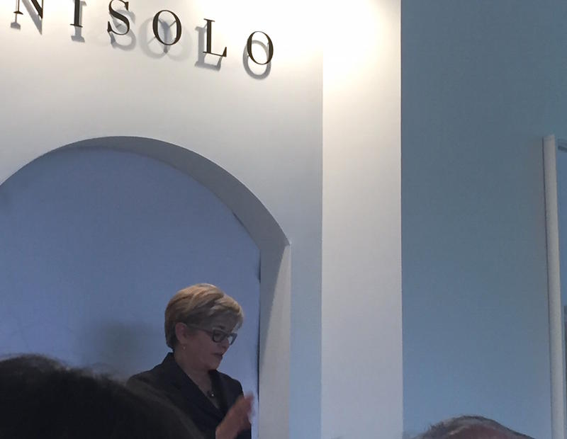 Van Tucker, CEO of the Nashville Fashion Alliance, presents on the economic impact report inside the showroom of Nisolo, a 5-year-old shoe company in Nashville.