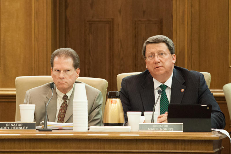 Senate Majority Leader Mark Norris, right, says a suit over refugee resettlement may be put on hold or withdrawn.