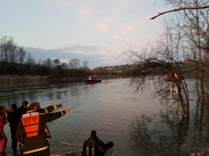 Emergency Responders search for Metro Police Officer Eric Mumaw in the Cumberland River