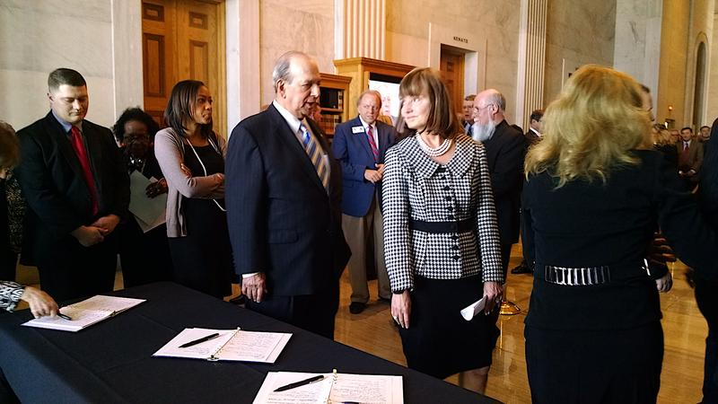 House Speaker Beth Harwell chats with former House Speaker Jimmy Naifeh in the receiving line for the family of former Sen. Douglas Henry.