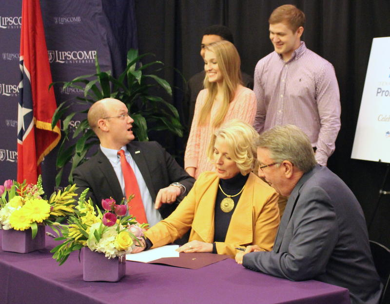 "THEC's Mike Krause, left, talks with Lipscomb transfer students as Flora Tydings with the Tennessee Board of Regents and Randy Lowry with Lipscomb sign the scholarship's ""memorandum of understanding."""