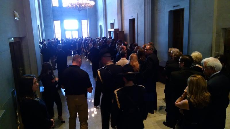 A crowd waits outside the legislature's ceremonial lounge to pay their respects to former Sen. Douglas Henry.