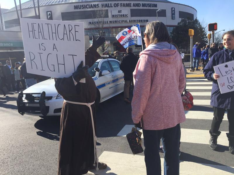 Protestors and Trump supporters outside Municipal Auditorium
