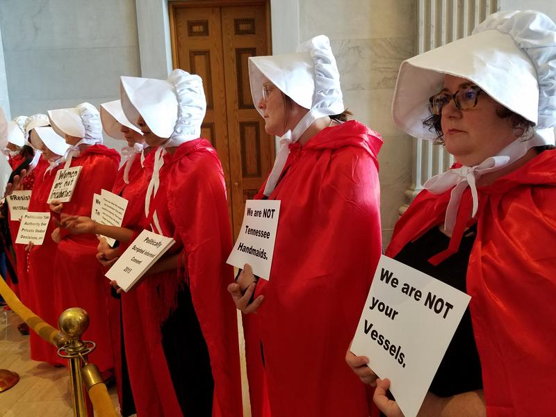"Abortion rights supporters dressed as women from the television series and novel ""The Handmaid's Tale"" on Monday to protest plans to restrict abortions past 20 weeks."