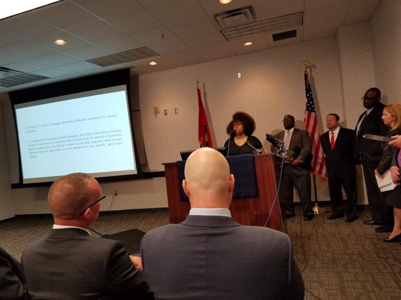 As TBI officials and prosecutors look on, Rasheedat Fetuga calls for the firing of Metro Police Officer Joshua Lippert after the fatal shooting of Jocques Clemmons.