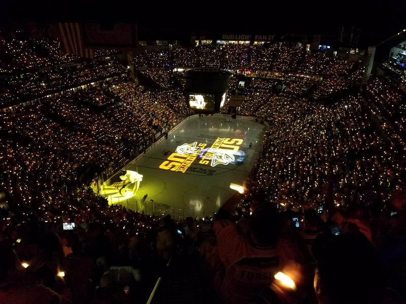 Bridgestone Arena is lit up before a Nashville Predators playoff game.