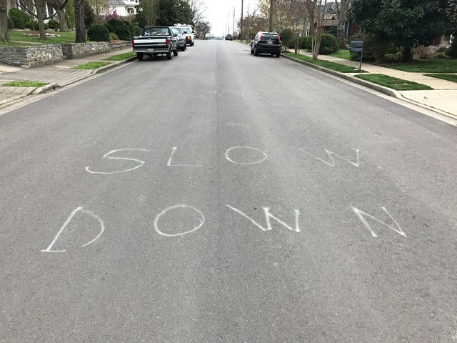 "Some neighborhood vigilantes have been trying to slow traffic in whatever ways they can — like painting ""slow down"" in the street."