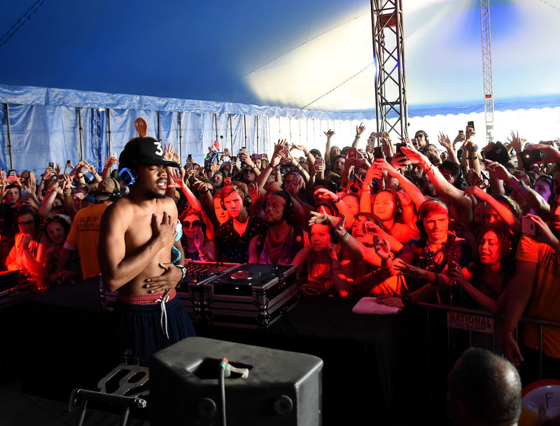 Chance The Rapper performs onstage at Bonnaroo's Silent Disco in 2016. The artist is playing a main stage at this year's fest.