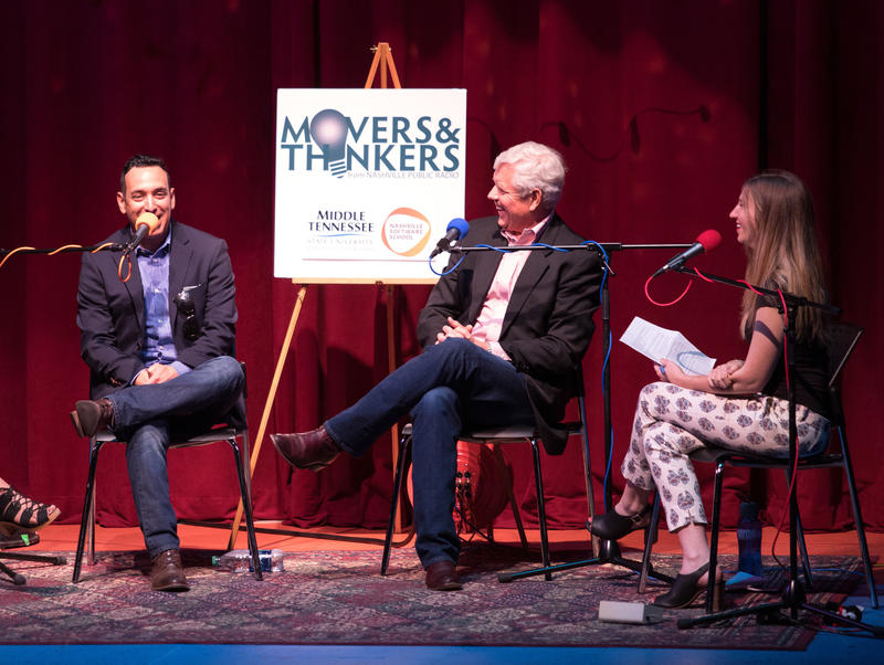 Chris Echegaray, left, speaks at the Movers & Thinkers live taping at Podcast Party in May.