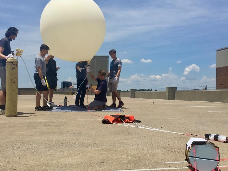A team of Vanderbilt students inflated the weather balloon with helium in preparation for their trial launch. They will repeat the launch on Aug. 21.