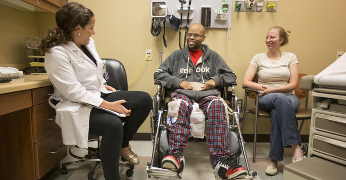A nurse practitioner at the Vanderbilt ICU Recovery Center follows up with a patient