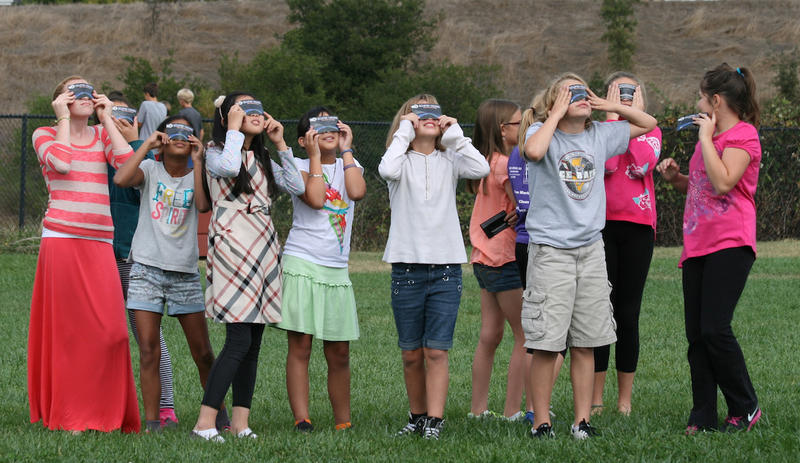 Except during the two minutes of totality, the sun is still dangerous to look at during an eclipse. NASA advises that people use eclipse glasses that meet the ISO 12312-2 standard.
