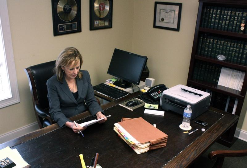 Alison Prestwood sits at her father's desk.