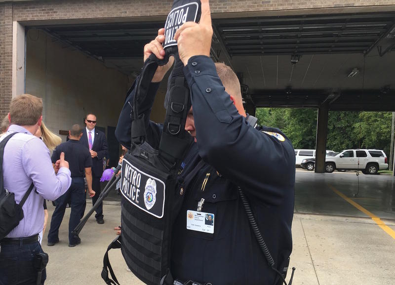 A Nashville police officer tries on new body armor purchased because of increased threats to law enforcement.