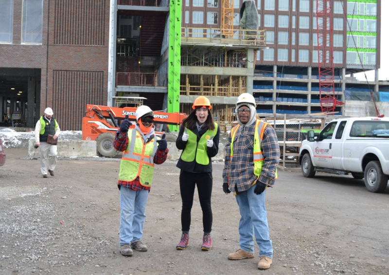 A staffer visits Project Return participants working at a local construction job site in 2016.