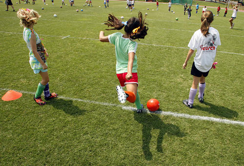 Young girls play soccer. A new state initiative would like to see athletic trainers at all youth sports activities.
