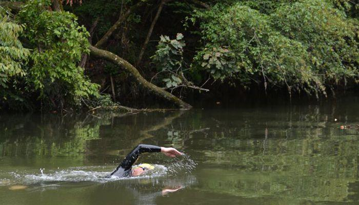 Andreas Fath swims the Tennessee River during the first of 34 days to travel its length.