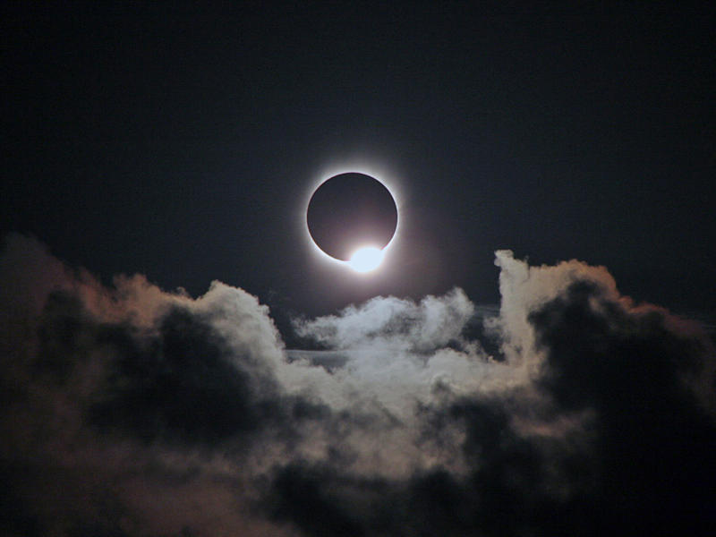 "Just before totality, a single point of sunlight shines down, creating an effect referred to as the ""diamond ring."""