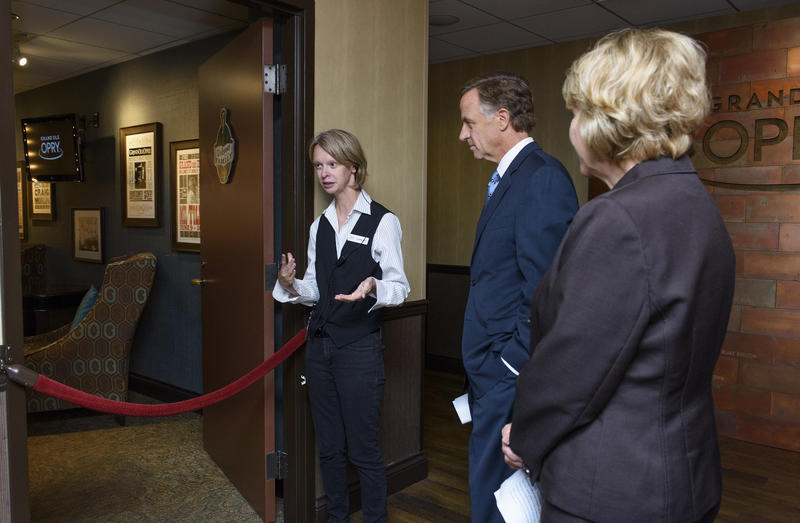 "Governor Bill Haslam (middle) gets a tour of the Grand Ole Opry before presenting the ""Expect Employment"" report in 2016. His administration has made jobs for people with disabilities a priority."