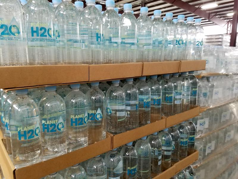 Bottles of Planet H2O water await shipment inside the company's production facility in Perry County.