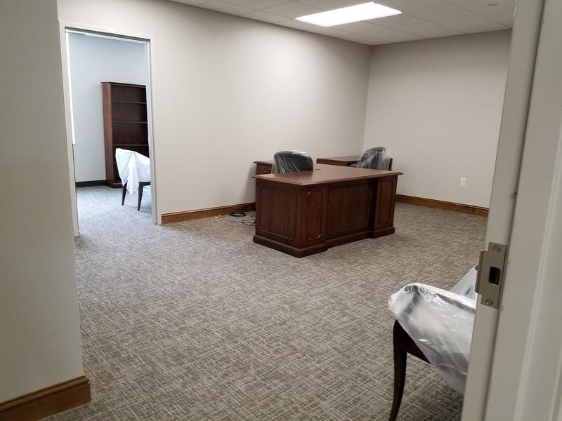 A typical office suite includes space for a receptionist, a legislator and an intern.