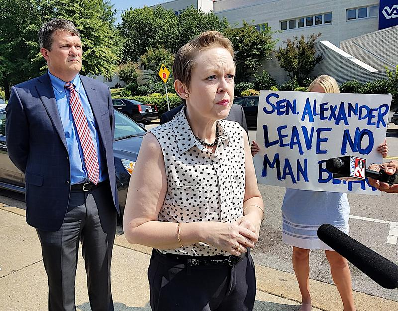 Kelly Gregory speaks to reporters outside the VA Hospital in Nashville about her opposition to the so-called Graham-Cassidy health care bill.